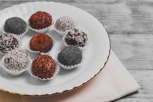 Serve Energy balls and sprinkled poppy, coconut, linseed, sesame, cocoa, almonds