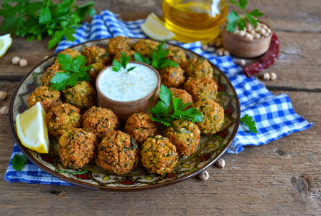 Falafel - deep fried balls of ground chickpeas with tahini sauce