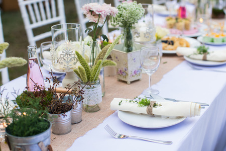 Outdoor dinner with homemade garnishes decoration.